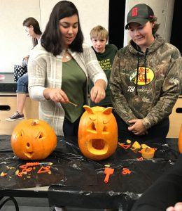Student and teacher with craved pumpkins
