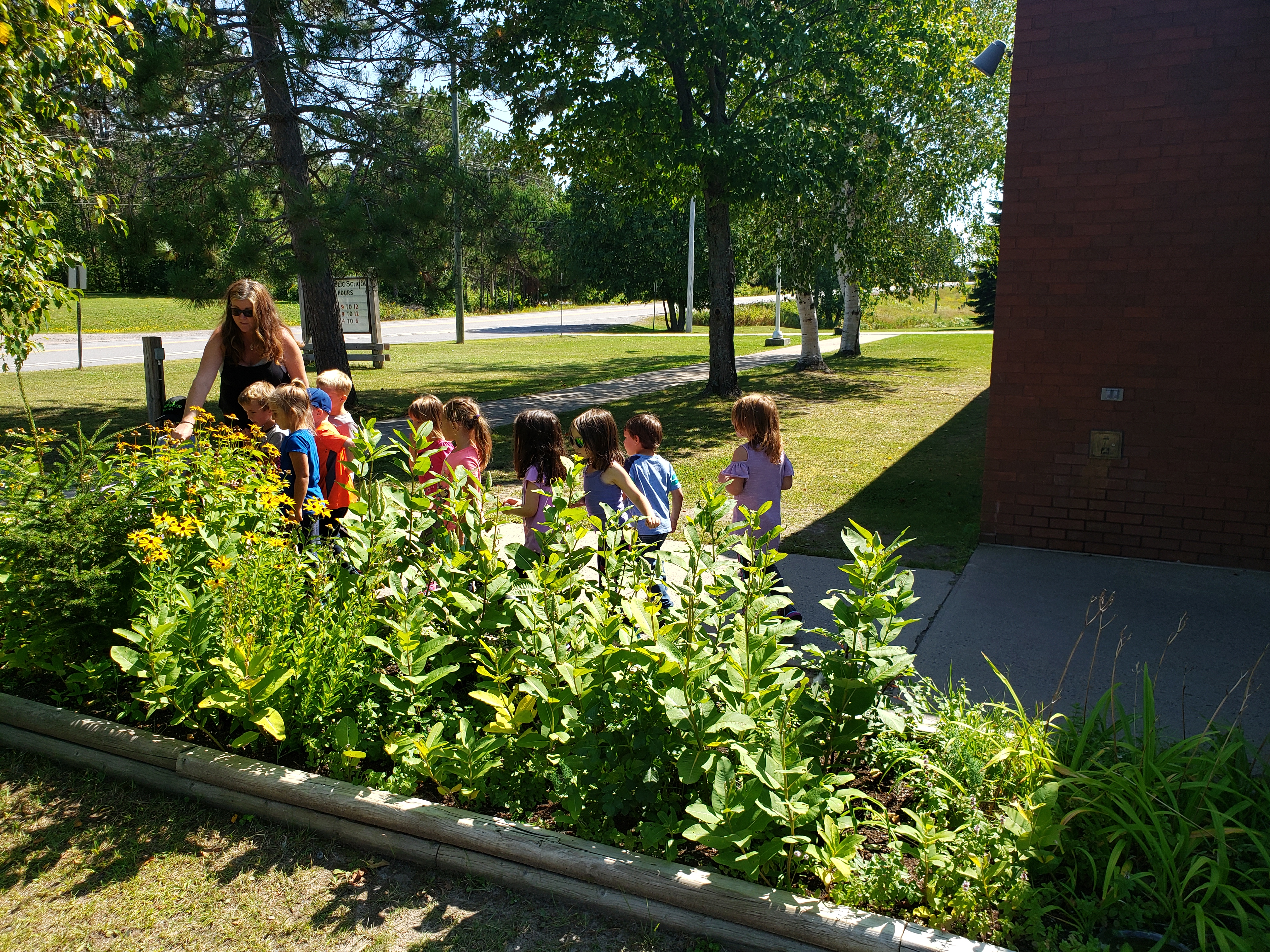 Class outside learning about plants