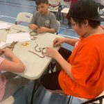 Students learning indigenous crafts