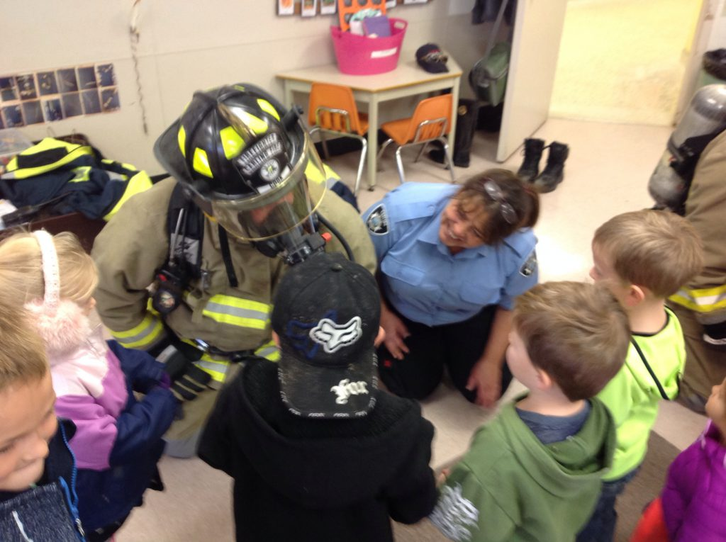 Firefighters enacting with students