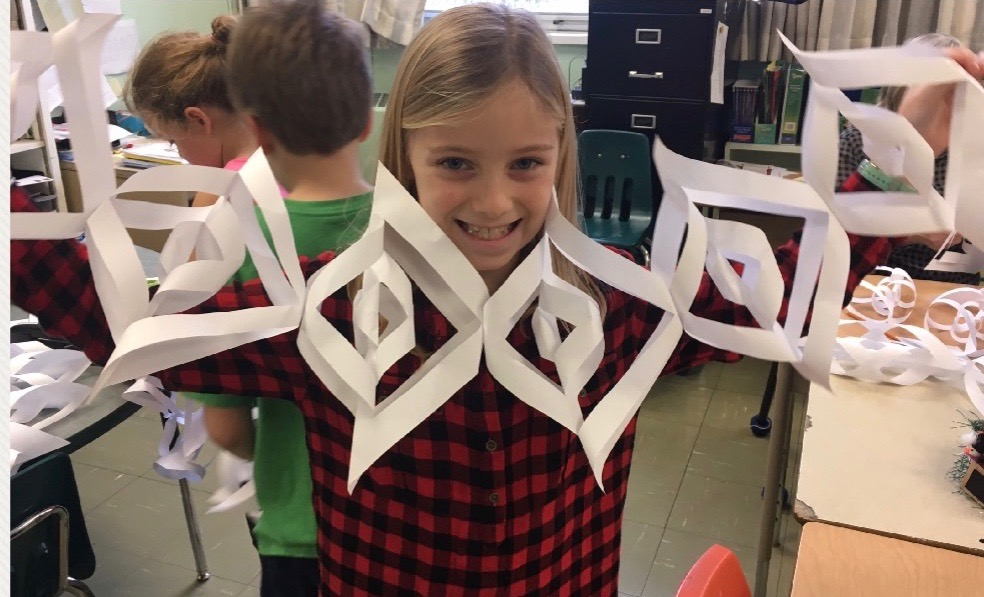 Student making snowflakes