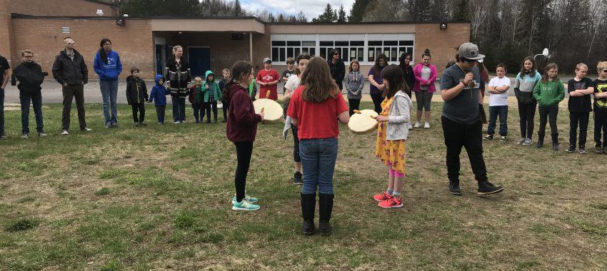 Students practicing Indigenous drum