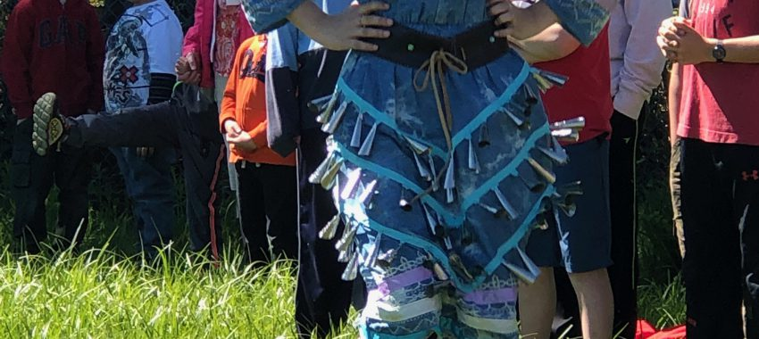 Student in traditional indigenous ribbon skirt
