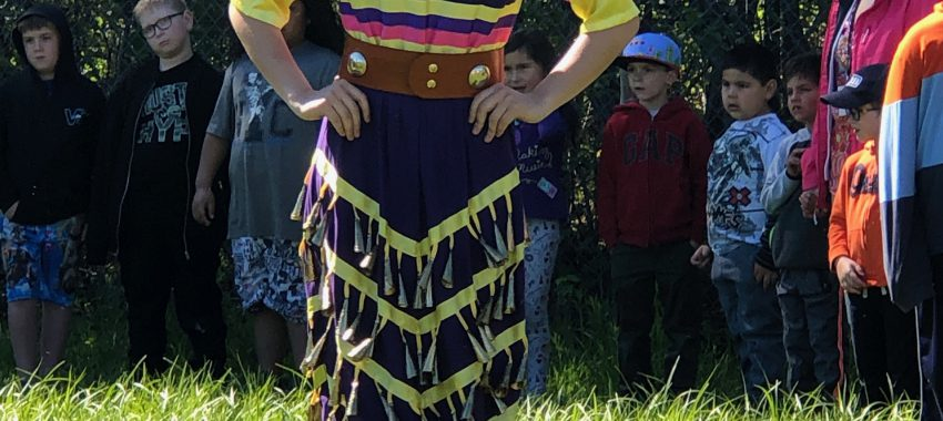 Student in tritonal indigenous ribbon skirt