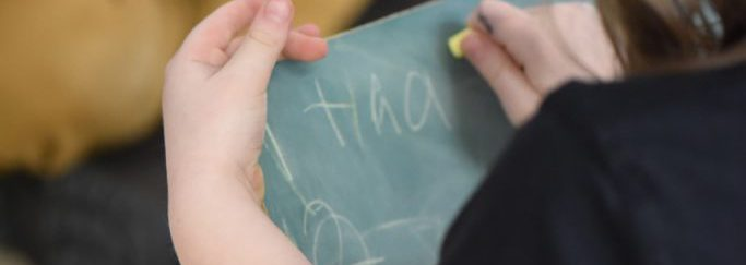 Student working on chalkboard