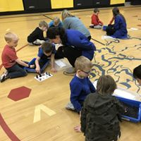Students learning in gym