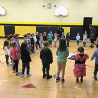 Students learning indigenous culture in gym
