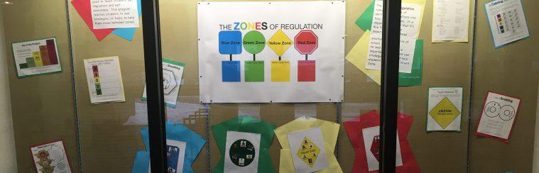 Zones of Regulations posters in glass case