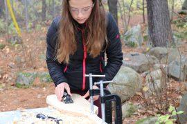 Photo of student plaining wooden paddle