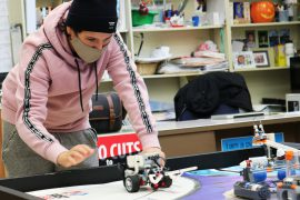 A student completes a maze with their robot