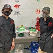 Dakota Walker and Mckenna Sproule showcase their cake decorating skills.