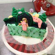 Mckenna Sproule showcases their cake decorating skills.