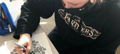 Hailey Finch creates Student Voice logo.